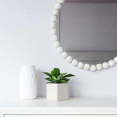 White Beaded Hanging Mirror Over White Dresser