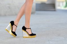 black, gold, and silver clogs