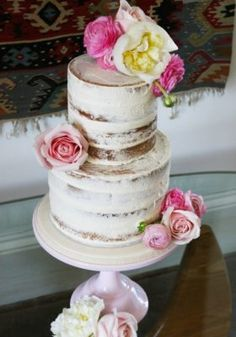 Two Tier Pink Flower Topped Wedding Cake