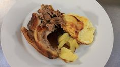 Slow cooked shoulder of pork with dauphinoise potatoes and apple sauce