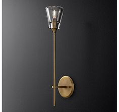 RH Modern's Torche De Verre Single Sconce:The torch form is distilled to its essence in this sconce from acclaimed lighting designer Jonathan Browning. The tapered glass shade is reminiscent of French neoclassical designs, while the solid brass frame is decidedly modern.