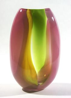 """$300.00 Boar Glass, Ben Hokanson & Trefny Dix, Silk Chiffon Vase in rasberry and citron. Each of these vessels have overlapping washes of color that creates a multidimensional pattern, like layers sheer fabric blowing in the wind. Their soft, puffed form adds to this feeling of buoyancy. Approximately 9.0""""h x 3.0""""w."""