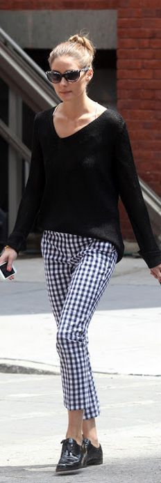 Who made  Olivia Palermo's black sweater and black and white print pants?