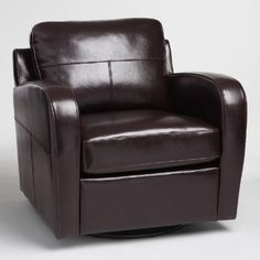 Our classic bi-cast leather chair is a luxuriously cozy spot to unwind in with 360 degrees of swivel comfort. Fine stitching details along the arms and ultra-plush backrest add to its handsome appeal.