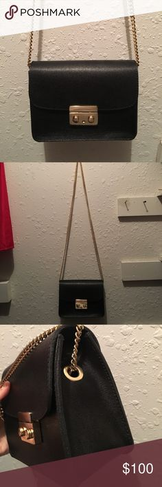 BLACK BAG FROM ITALY real leather Very cute bag. Black and gold never used but removed tag. Second to last picture proves it is from Italy. Real leather. Have any questions feel free to ask me! ITALY Bags Crossbody Bags