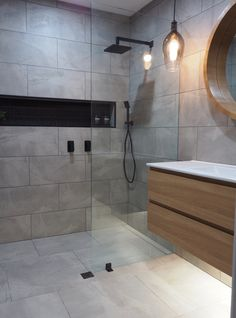 Grey tiles and wooden vanity