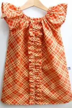 Sweet and simple.    Flutter Sleeve Ruffle Peasant Dress in Orange Plaid-6m -6 by Smashed Peas and Carrots. $36.00, via Etsy.