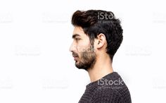 Profile view of serious young man over white background royalty-free stock photo