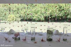 Grullas y orquídeas para la mesa principal