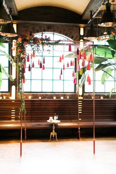 wedding ceremony arch with dangling tassels - photo by Haley Sheffield Photography event and floral design by Juli Vaughn Designs http://ruffledblog.com/bright-modern-NYC-wedding