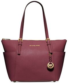 Before you jet off to Joburg, be sure to bring along this fabulously sleek silhouette from Michael Michael Kors. Sumptuous leather, luxe hardware and elegant contours make it the ultimate travel compa