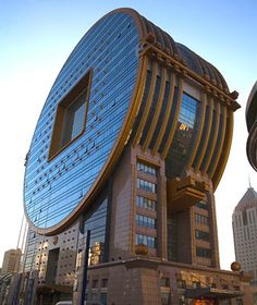 The Fang Tuan Building in Shenyang, China;  a 25-floor office building which looks much like an old Chinese coin, which have square cutouts;  designed by C. Y. Lee