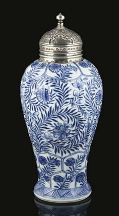 A KANGXI (1662-1722) ISLAMIC MARKET BALUSTER VASE, CHINA   With later silver cover, decorated to the body with underglaze blue chrysanthemum scrolls and flowers, below and above bands of flowers in shaped cartouches - 11 in (27.9cm) high
