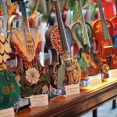 :: Pretty painted violins.