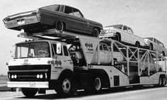 1962 Chevy COE truck hauling 1962 Oldsmobiles and Chevrolets.