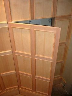 Secret Door in Wood Panel This custom wooden stair installation by Michael Uhthoff includes a secret opening door panel. Hidden Spaces, Hidden Rooms, Wooden Stairs, Wooden Doors, Hidden Doors In Walls, Invisible Doors, Hidden Cabinet, Closet Door Makeover, Basement Makeover