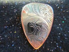Beautiful Silver and Copper Guitar Pick.  Click on the picture to buy!