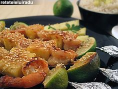 Shrimp skewers with pineapple, lime and sesame seeds, served with steamed white rice