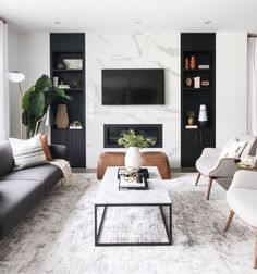 neutral modern living room with marble fireplace, black and white living room decor, Leclair Decor ( Home Living Room, Interior Design Living Room, Interior Livingroom, Living Room Contemporary, Dark Sofa Living Room, Contemporary Living Room Designs, Dark Couch, Modern Room Design, Classy Living Room