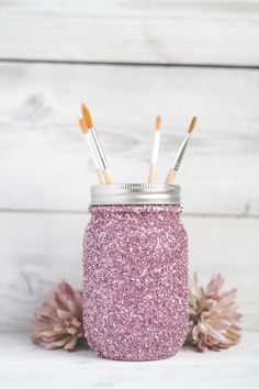 DIY Glittery Mason Jar Makeup Brush Holder | 15 New Ways To Wear Glitter, check it out at http://makeuptutorials.com/ways-to-wear-glitter-makeup-tutorials