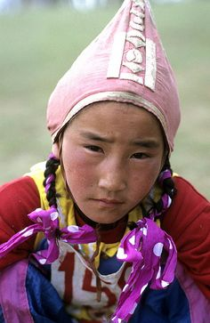 Asia   Portrait of a young girl wearing a traditional hat, Mongolia   © Claude  Barutel  #cap