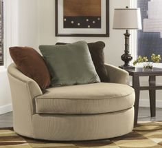 Signature Design By Ashley 7070421 Laken Oversized Round Swivel Chair with Metal Base, Ribbed Fabric Upholstery and 3 Back Pillows in Mocha