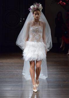 Naeem Khan Fall 2016 mini wedding dress with sheer embellished bodice and feathered skirt | https://www.theknot.com/content/naeem-khan-wedding-dresses-bridal-fashion-week-fall-2016