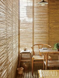 Bamboo shielding light creates an intimate nook.