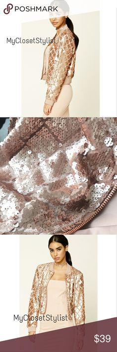 """Forever 21 Sequin Bomber Metallic Jacket OS/L FOREVER21 100% Authentic  A woven bomber jacket featuring a sequined geo pattern!! ROSE GOLD color looks similar to peach and has pretty copper hued zip in front! Dress it up or down.  • Geometric Diamond Pattern adds interest • Fully Lined • Long sleeves • Zipper front • Slanted front pockets • Ribbed trim  Size Large fits like a OS (one size fits all).  u-u 21"""", front length 20.5"""" hits at high hip.  Excellent Condition. Sold Out.. A Steal. Only…"""