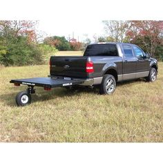 The Swivelwheel trailer behind a Ford F150