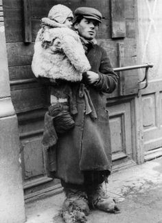 Warsaw, Poland, A boy holding a child in his arms.                                                            Belongs to collection:        ...