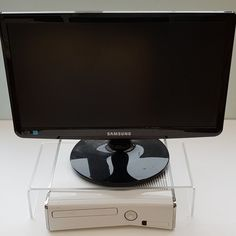 This is perfect for displaying technology items as it fits over many smaller sized set top box units.  Product Details... Material: Satin acrylic 5mm The display stand has the following dimensions: Height - 8cm : Width - 35.5cm : Depth - 18cm