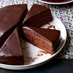 Sacher Torte | Sacher torte is a classic Austrian chocolate cake layered with apricot preserves. Lidia Bastianich's version uses the preserves three ways: for moistening the cake layers, as a thick filling between the layers and as a glaze to seal the cake before covering it in chocolate.  #FOODWINEWOMEN