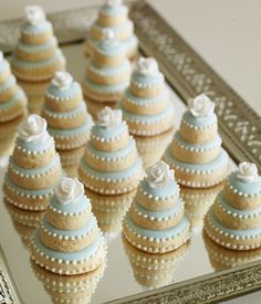 sugar cookies stacked into mini wedding cakes.