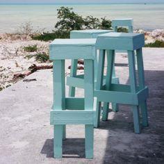 Empty bar seats, a concrete slab, and a calm sea.  West Indies
