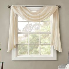 """Bring a beautiful new look to your window with this Madison Park Kaylee solid crushed scarf valance.FEATURES 1 window scarf 4 tabs for easy assembly Lightweight sheer crushed fabric for texture SIZING 42"""" x 144"""" 42"""" x 216"""" CONSTRUCTION & CARE Polyester Machine wash Imported  Size: 42X144. Color: White. Gender: female. Age Group: adult."""