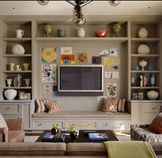 Love the TV placement & bench; providing extra seating & storage.