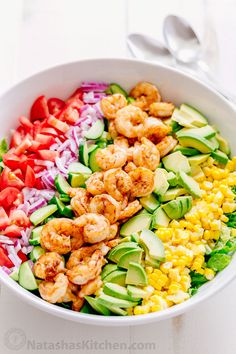 We could live off this shrimp avocado salad. It's crazy good and loaded with avocado, cucumbers, tomatoes, sweet corn and tossed with a light and easy cilantro-lemon dressing. This shrimp salad has all the best flavors of summer! WINNER!!   natashaskitchen.com