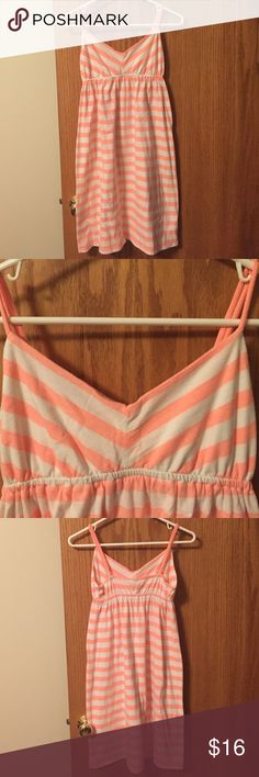 Coral/cream striped tank dress ON size SM. Very comfy old navy, empire waist tank dress. Size small. Only worn once or twice. Excellent condition. No flaws. Easy throw on dress that can be casual or dressed up with accessories. Great mid length, came just above our knees. That great bright pink/orange on the verge of fluorescent color. I had (have) the same dress in mint for a luau at DisneyWorld. ☺️ Old Navy Dresses Mini