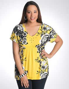 In an eye-catching floral print with studded shoulders for a hint of shine, this lovely knit top flatters any shape with a V-neck and empire waist. Short sleeves. lanebryant.com