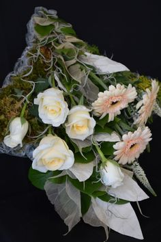 A cushion decorated using a sheaf of flowers.