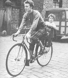 Beryl burton with Denise in back of bike