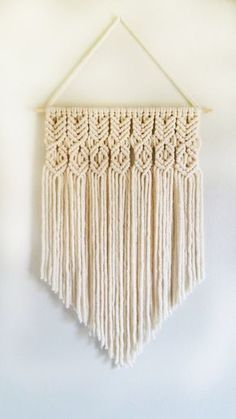 Color: Cream Size: 24 inches wide, 30 inches long Warning: Please keep out of reach from small children, may be a suffocation hazard. Modern Macrame, Macrame Art, Macrame Projects, Macrame Wall Hanging Patterns, Macrame Patterns, Hanging Tapestry, Yarn Wall Art, Deco Luminaire, Deco Boheme