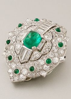 An Art Deco emerald and diamond clip brooch, French, circa 1930. With marks. #ArtDeco #ClipBrooch