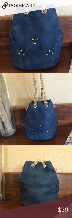 "New Blue Bucket Bag with gold hardware 💙👜💙👜 This blue bucket bag features and ever trending shape and Eye catching link chain shoulder strap, this stand out bag finishes your ensemble in bold style! Dual adjustable chain shoulder strap, drawstring closure, exterior features goldtone hardware, approx 9.75""high x6.5"" wide x 6.75""in depth. Strap drop is approx 12 to 25 "".  Vegan leather exterior and fabric lining. ❌trades ✅ same or next day shipping ❌ no offers, priced to sell, bundle to…"