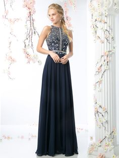 An elegant prom gown with a full skirt that reaches the floor. The ...