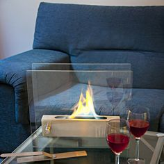 Tabletop Biofireplace Hearth: Runs on biofuel designed specifically for bio fireplaces without chimneys. Combustion is odorless.