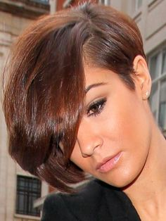 Frankie from the Saturdays with an asymmetric heavy fringed bob. Marc Young Opus 3 2 7 8 would be used when cutting this style.