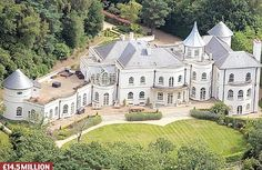 Drogba's English manor.   English National Team striker, and lead man for Manchester United, Wayne Rooney also calls the English countryside home. Outside of Manchester you can find his elegant, U-shaped home resting in an enclave of overhanging trees. The design certainly borrows influences from classic English estates, but spices it up with a palatial patio surrounding the home and a colossal sunroom to top it all off.