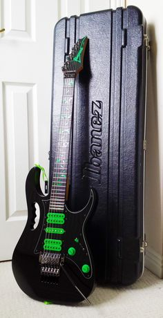Ibanez Jem 777VBK + Ibanez Case The 6 string version of the Black and Green monster.